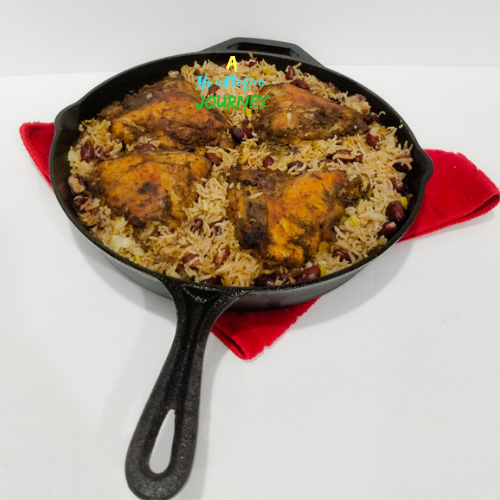 One Pot Jerk Chicken with Rice and Peas in a large cast iron skillet.
