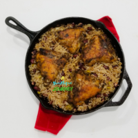 One Pot Jerk Chicken with Rice and Peas Recipe in a cast iron skillet.