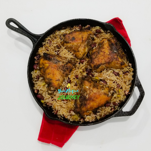 One Pot Jerk Chicken with Rice and Peas in a cast iron skillet.